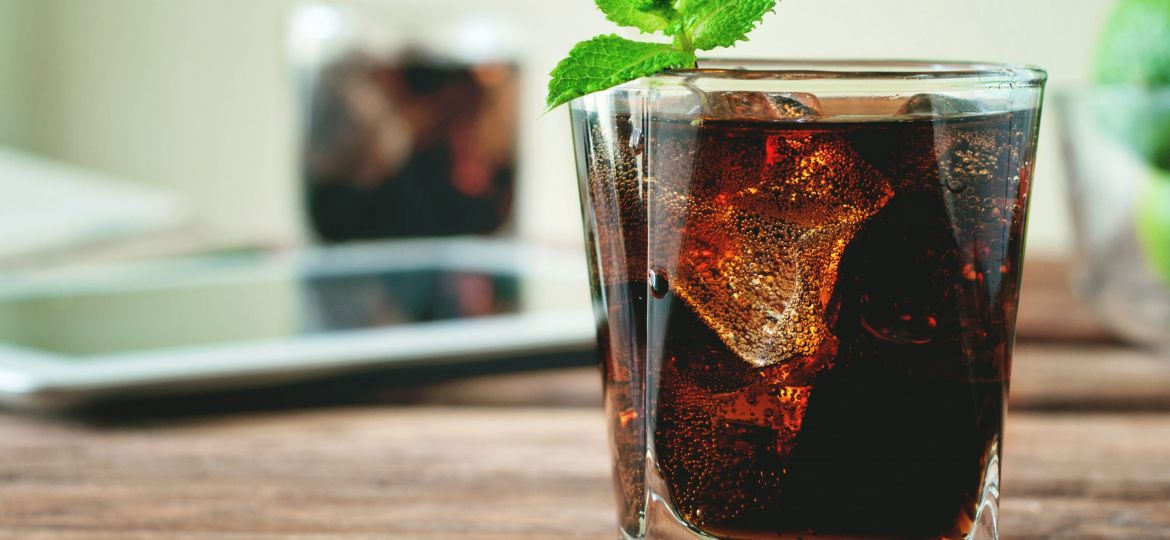 glass of cola poured to the brim