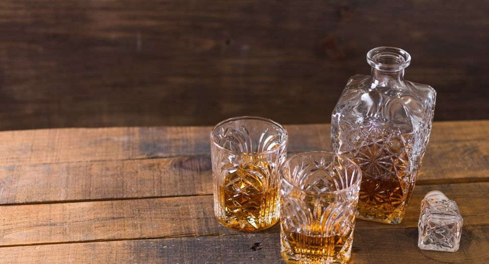 whiskey in glass on wood background