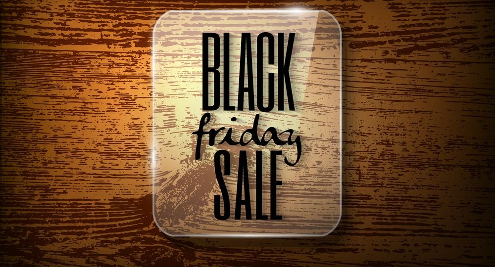 Black friday announcement  in glass frame on  vector wooden back