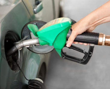 a Person Refueling the Car at a Gas Station